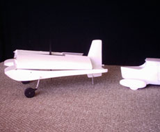 The car drives to the trailer connection position and the pilot folds and locks the wings in position for highway travel
